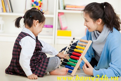 happy asian kid playing with teacher